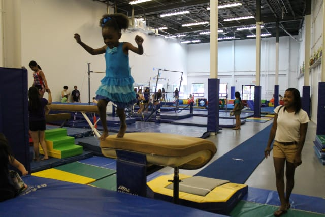 Local families enjoy open play at the new Y Gymnastic Center's grand opening party on June 28 at the new location of 145 Main St. in Norwalk.