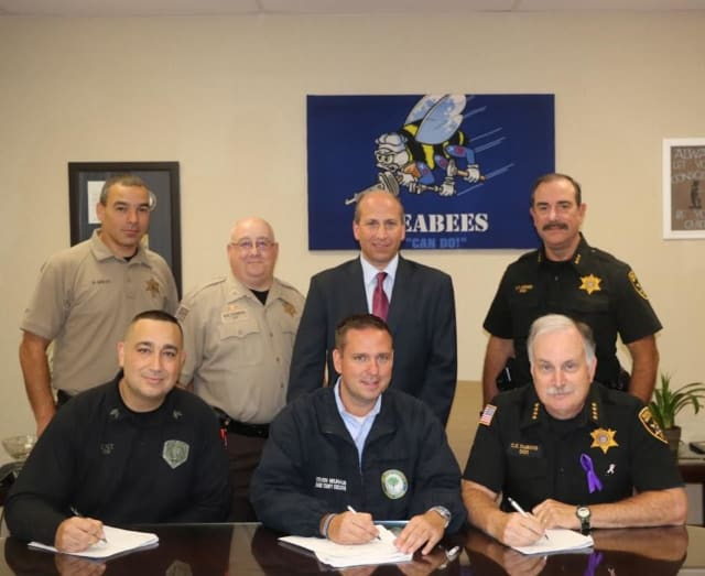 Orange County officials agreed to terms on new contracts for the Orange County Corrections Officers Benevolent Association (COBA) and the Superior Officers Association (SOA).