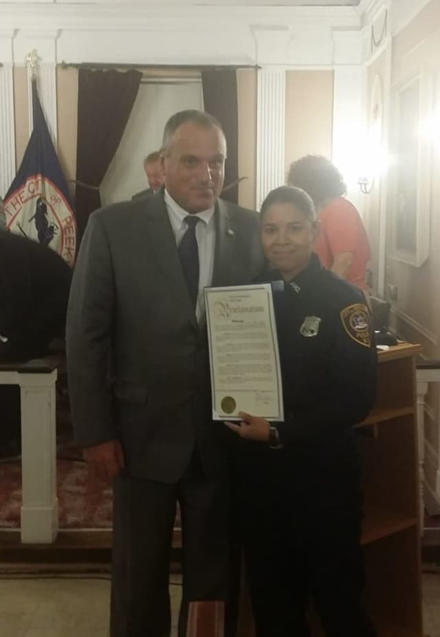 Peekskill police Officer Elizabeth Folch was honored for her work with the Hispanic community Monday. Presenting the proclamation was Mayor Frank Catalina.