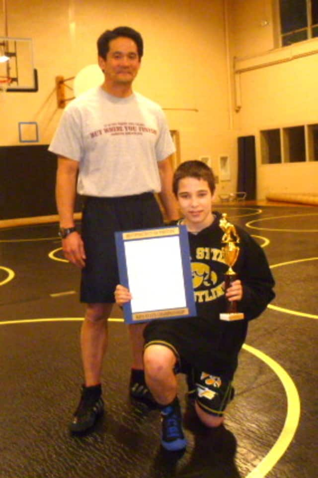 Easton's Carson LiCastri won the Connecticut Kids State Wrestling Championship in his weight division. He is pictured with coach Michael Matsuoka.